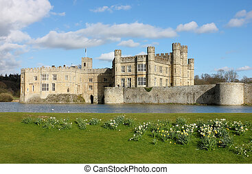 Leeds Castle in Kent, United Kingdom. Frontal view with blooming daffodils.