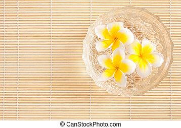 Leelawadee flowers in the water on bowl