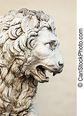 leeuw, gebeeldhouwd kunstwerk