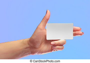 Left Female Hand Hold Blank White Card Mock-up. SIM Cellular Plastic NFC Smart Tag Call-card Mock Up Template. Credit Namecard or Transport Ticket. Christmas Store Discount Loyalty Gift. Copy space.