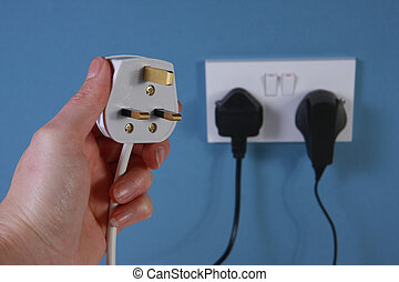 Left hand holding a plug