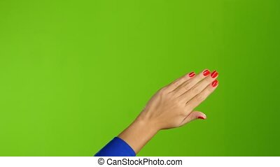 Left hand is widely waving goodbye or hello. Green screen -...