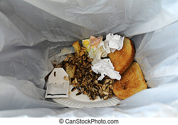 Left over food in garbage - Leftover food and trash in a...