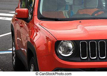 Left side of the orange vehicle