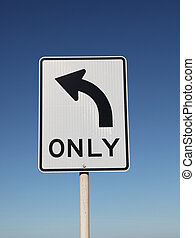Left Turn Only Sign with blue sky background