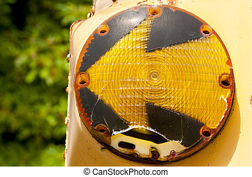 Left turn signal - Worn-out left turn signal in junk yard