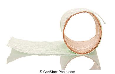 Leftover tissue paper roll on white isolate