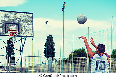 Lefty basketball player shooting in a playground