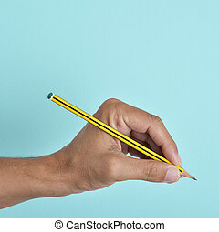 lefty man with a pencil - the hand of a left-handed man with...