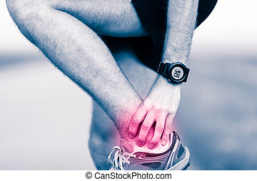 Leg ankle pain, man holding sore and painful foot - Ankle ...