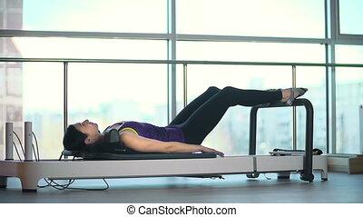Leg Press - Pretty girl working out her leg muscles