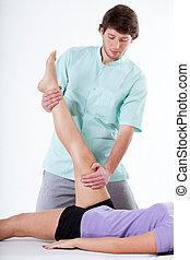 Leg rehabilitation at physiotherapy cabinet