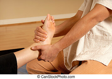 Leg stretch - therapist giving a massage and leg stretch