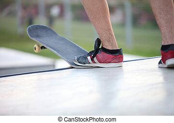 leg with a skateboard