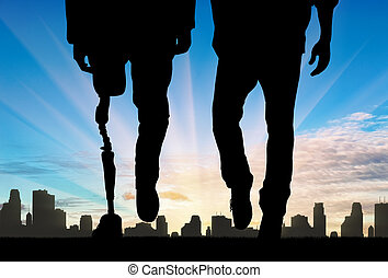 Leg with artificial limb and normal feet background of city day