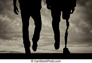 Leg with artificial limb and normal feet black and white -...