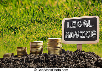 Legal Advice - Financial opportunity concept. Golden coins in soil Chalkboard on blurred urban background