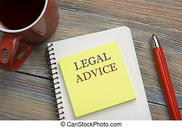 Legal Advice. Notepad with message, coffee cup and red pencil. Office supplies on desk table top view