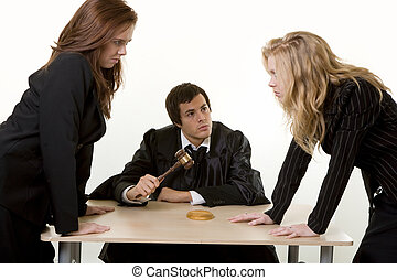 Legal argument - Male judge sitting at a desk with one...