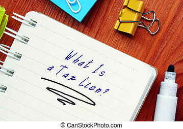 Legal concept meaning What Is a Tax Lien? with inscription on the piece of paper.