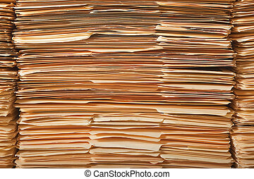 Legal File Pile - Tall stack of paper legal file folders.