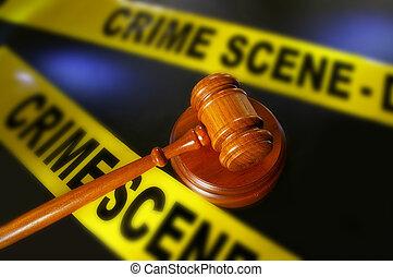 legal gavel and police crime scene tape