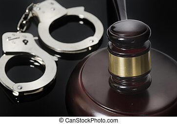 Legal law concept gavel and handcuffs