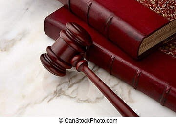 Legal still life - Gavel and law books shot on marble...