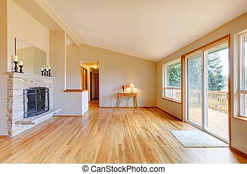 lege, woonkamer, met, een, openhaard, en, glas, schuifpui