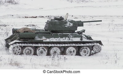 MOSCOW, RUSSIA - DECEMBER 25: Legendary Russian Tank T34. Video taken during a battle re-enactment at the Stalingrad Battle show on December 25, 2011 near Moscow