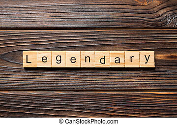 Legendary word written on wood block. Legendary text on wooden table for your desing, Top view concept