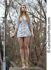 Leggy blond woman - Barefooted leggy blond woman posing like...