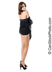 leggy brunette - Young leggy brunette posing in black shirt....