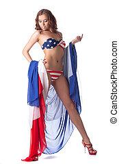 Leggy model posing in bikini with american flag, isolated on...