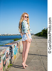 Leggy young blond woman