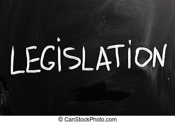"""Legislation"" handwritten with white chalk on a blackboard."