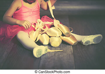 legs a little ballerina with ballet pointe shoes and pink skirt tutu