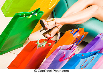Legs and bags - Photo of female legs with colorful shopping...