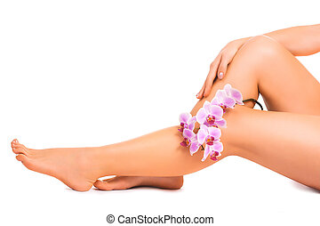 legs and hand with orchid flower. epilation - Beautiful...