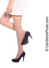 Legs and High Heels on White Background