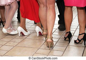 Legs and shoes dancing women