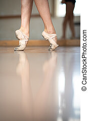 Legs and slippers of classical ballet dancers
