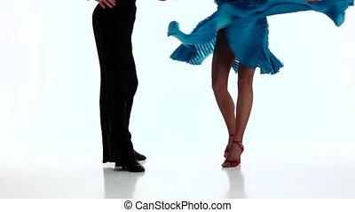 Legs couple ballroom dancers perform rumba, white...