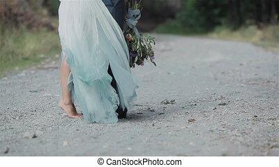 Legs couple kiss bouquet surprise