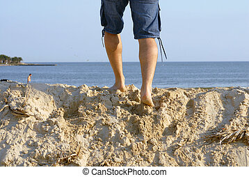 Legs from a man on the beach