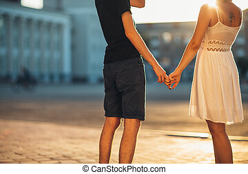 legs guy and the girl embracing on a background of city
