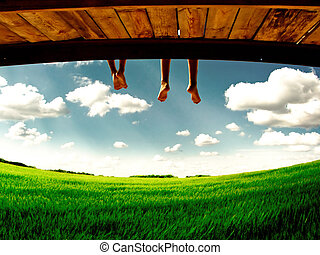 legs hanging on nature - two teenagers legs hanging down on...