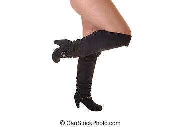 Legs in black boots.