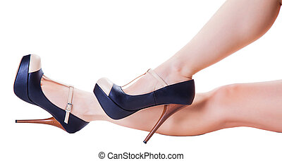 legs in high-heeled shoes