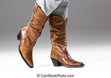 Legs in Jeans and Cowboys Boots